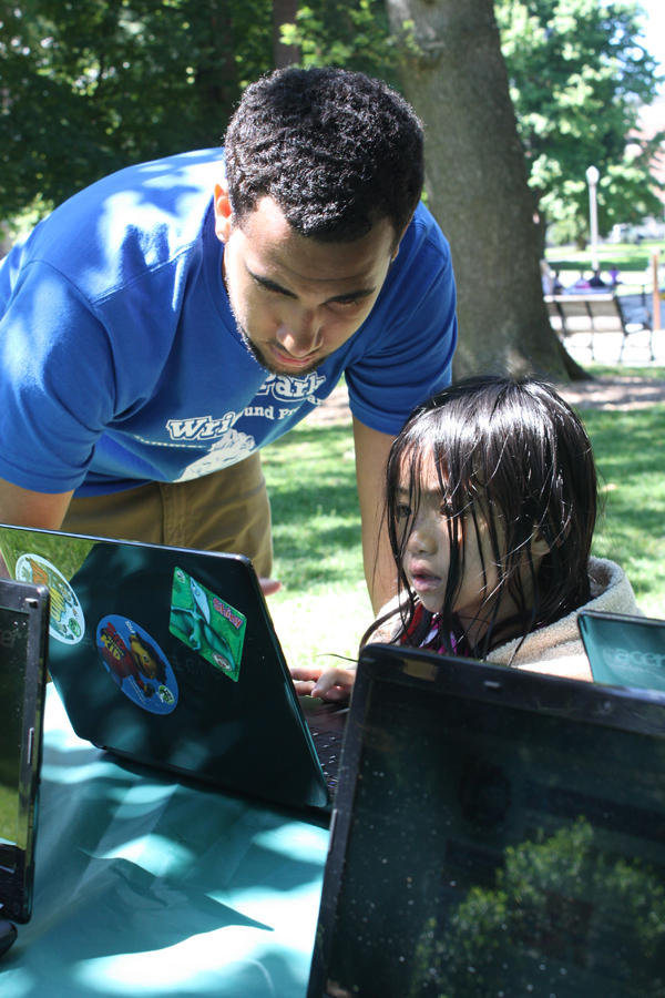 A summer KBTC Ready To Learn Mobile Technology Lab camper is sharpening her math and literacy skills in Wright Park in Tacoma, WA. Source: KBTC Public Television
