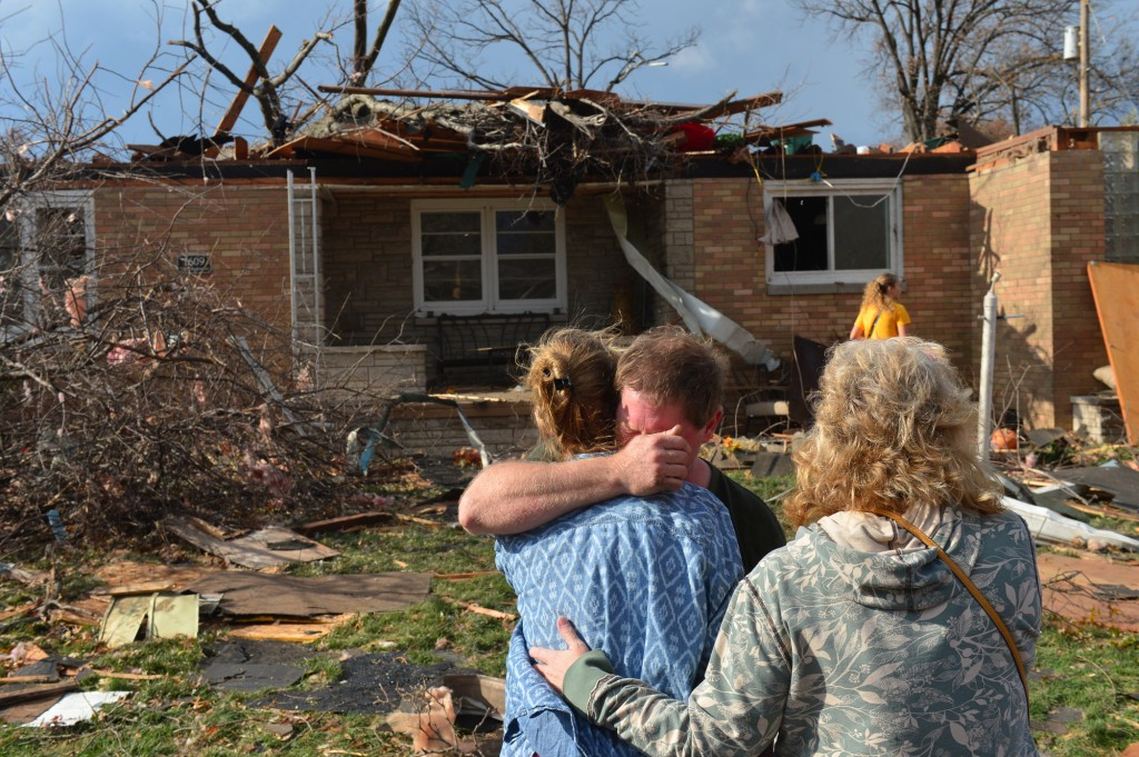Ray Baughman embraces family shortly after his home was destroyed by a tornado that left a path of devastation through the north end of Pekin, Il., Sunday, Nov. 17, 2013. Fred Zwicky, AP Photo/Journal Star
