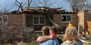 Ray Baughman embraces family shortly after his home was destroyed by a tornado that left a path of devastation through the north end of Pekin, Il., Sunday, Nov. 17, 2013.  Photo credit: Fred Zwicky, AP Photo/Journal Star