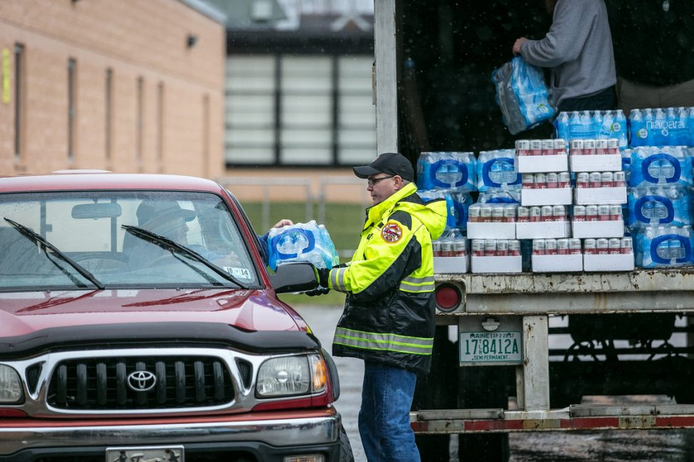 Members of the Nitro Volunteer Fire Department distribute water to local residents on Saturday. Photo credit: Michael Switzer/AP
