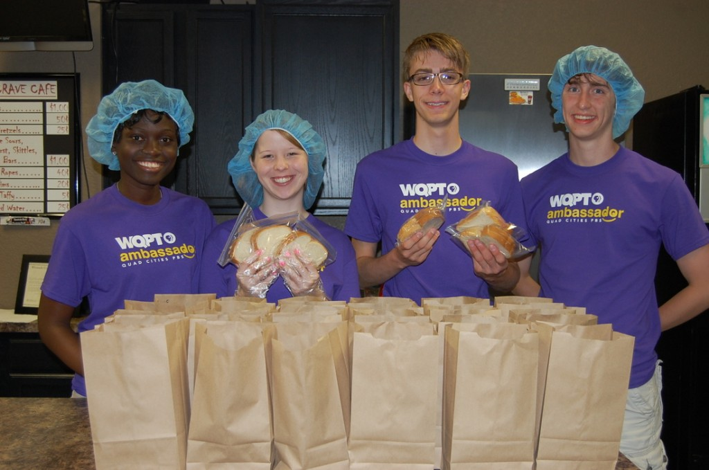 WQPT ambassadors pack lunches for a station event.