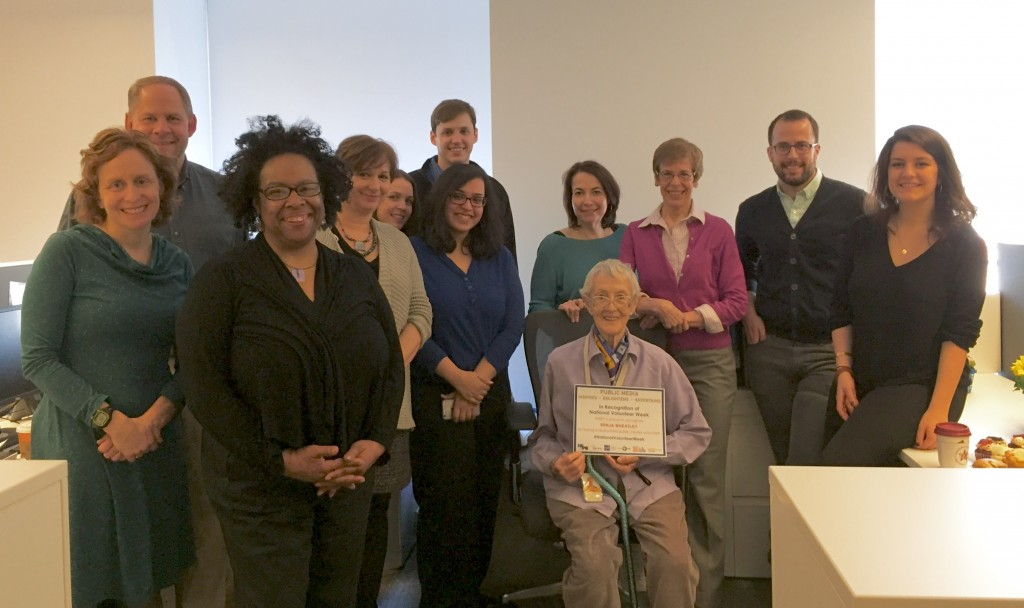 WNET public media volunteers pose with a certificate from their station.